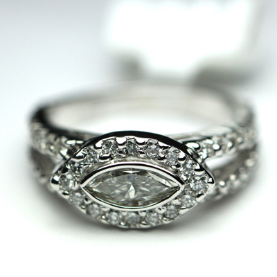 east west diamond ring setting with diamonds down the band