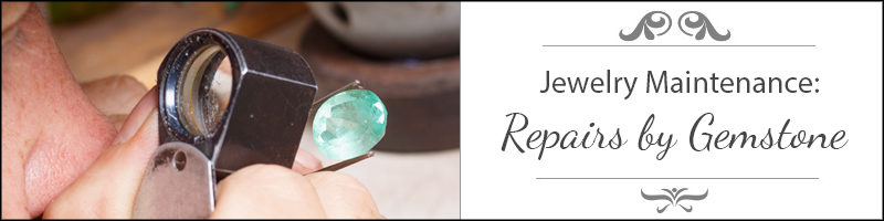 jewelry repair of aquamarine gem by jeweler looking through magnifier